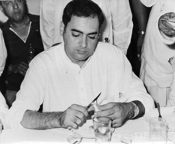 Rajiv Gandhi is seen cutting a fruit. (Express archive photo)