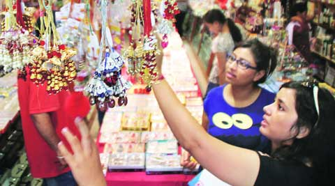 Girls select lumba raakhi at a Sarabha Nagar shop on Saturday. (Source: Express photo by Gurmeet Singh)