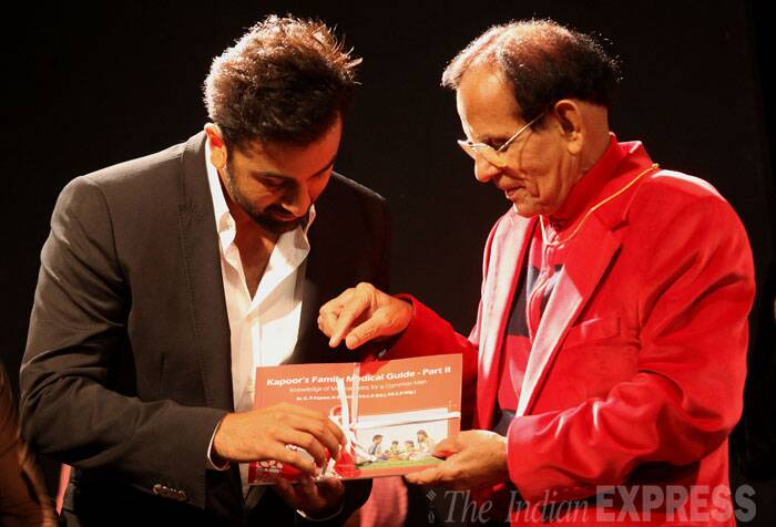 Ranbir Kapoor unveils the book with their family doctor.  (Source: Express photo by Prashant Nadkar)