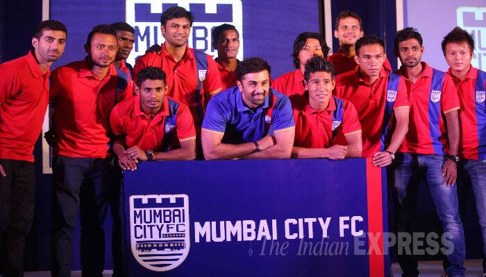 The actor strikes a pose proudly with his team boys. (Source: Express photo by Kevin DSouza)