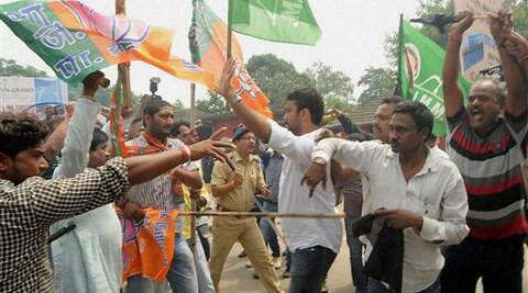 BJP workers clash with JMM workers who showed black flags to Union Steel Minister Narendra Singh Tomar at Hinoo Chowk in Ranchi on Saturday. (Source: PTI)