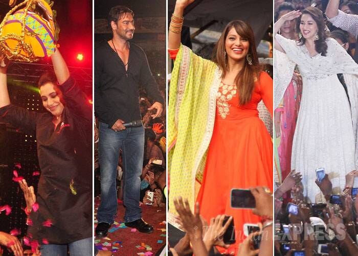 In true spirit of the festival of Janmashtami, Bollywood celebrities Ajay Devgn, Bipasha Basu and Madhuri Dixit took part in the festivities across Mumbai on Monday (August 18). And Rani Mukerji, who is all set to play a tough cop in Mardaani turned Govinda during the celebrations.  (Source: Varinder Chawla)