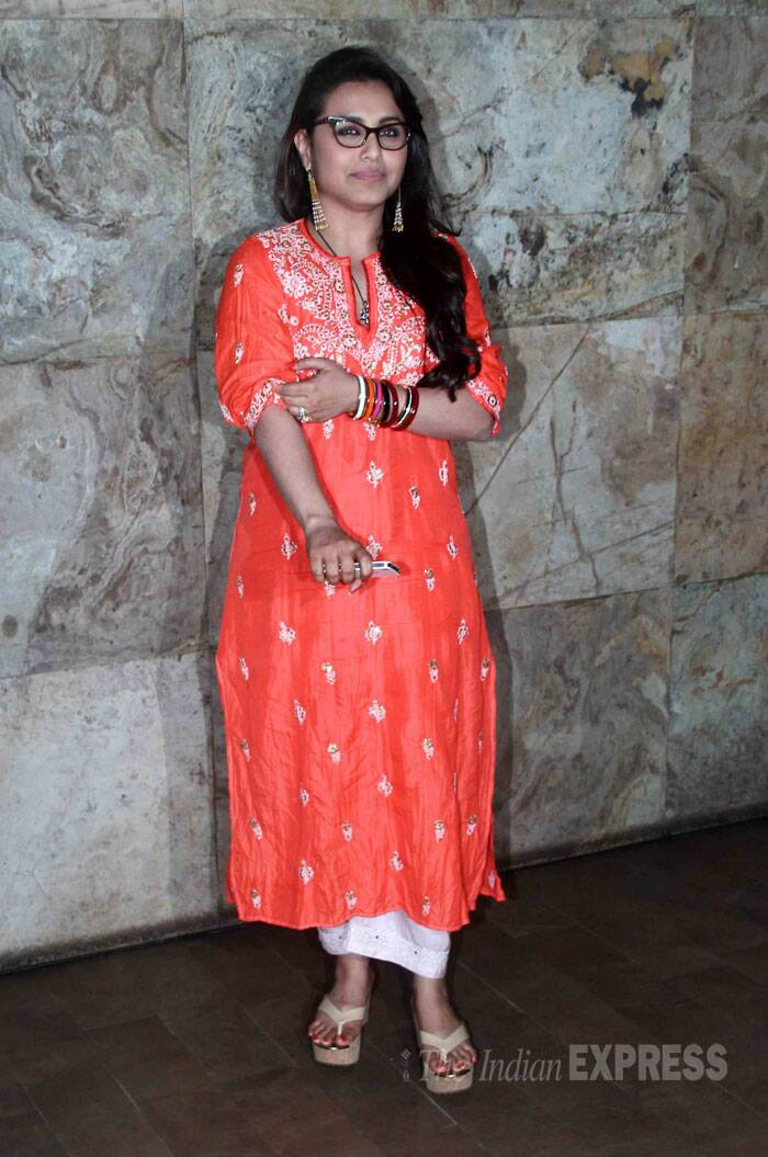 Newly married Rani Mukerji wore a bright orange kurta with white palazzos. She kept her look simple with colourful wooden bangles in one hand. (Source: Varinder Chawla)