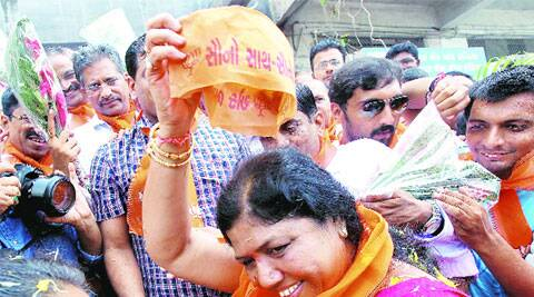 Ranjan Bhatt celebrates after the BJP nominated her from Vadodara. (Source: Express photo by Bhupendra Rana)