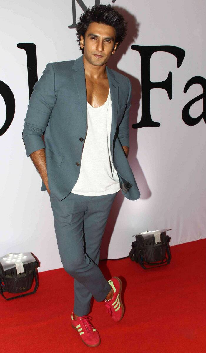 Joining the ladies on the best-dressed list is none other than Bollywood hunk Ranveer Singh. Known for his extremely brave choices on the red carpet, Ranveer looked hot in grey with a white tee shirt, red sneakers and spiked hair. (Source: Varinder Chawla)