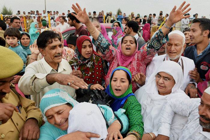 Another 300 are reported to have booked themselves with private tour and travel operators.<br /><br /> Relatives shouts slogans as they bid an emotional farewell to Haj pilgrims outside Haj House Bemina in Srinagar. (Source: PTI Photo)