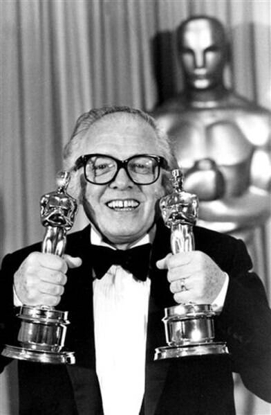 "FILE - In this Monday, April 11, 1983 file photo, British actor and director Richard Attenborough holds his two Oscars for his epic movie ""Gandhi"" at the 55th annual Academy Awards in Los Angeles. (Source: AP)"