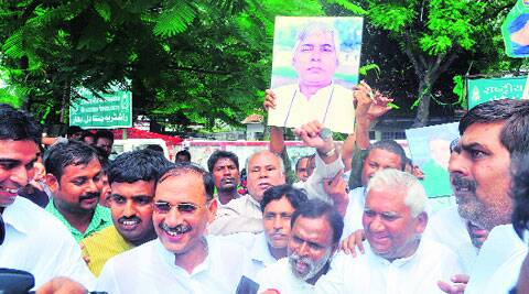 RJD supporters celebrate with a portrait of Lalu Prasad, who is in hospital in Mumbai. (Source: Express photo by Prashant Ravi.)