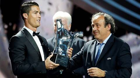 Christiano Ronaldo recieving UEFA' best player award on Thursday by Micael Platini, Presdient, UEFA. (Source: Reuters)