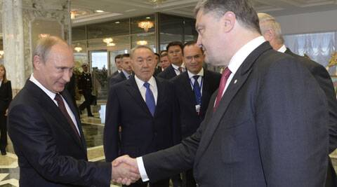 Russian President Vladimir Putin, left, shakes hands with Ukrainian President Petro Poroshenko, right, as Kazakh President Nursultan Nazarbayev, center, looks at them, prior to their talks after after posing for a photo in Minsk, Belarus, Tuesday, Aug. 26, 2014. (Source: AP)
