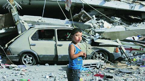 A 4-year-old Palestinian boy walks past destroyed buildings in Gaza City Thursday. ( Source: AP )