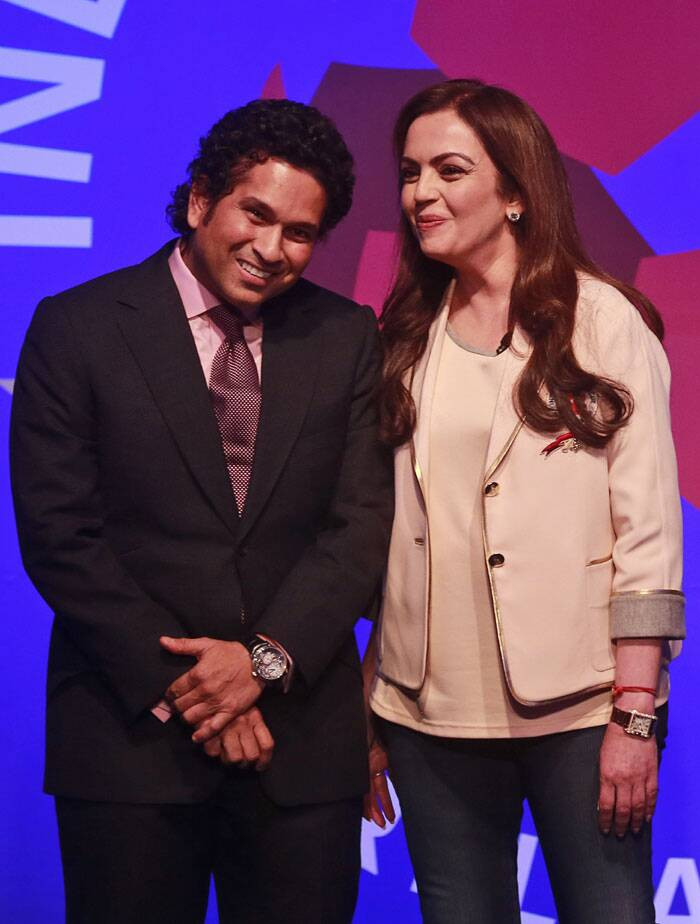 Tendulkar shares a light moment with Nita Ambani, who also owns the Mumbai Indians unit of the Indian Premier League (Source: PTI)