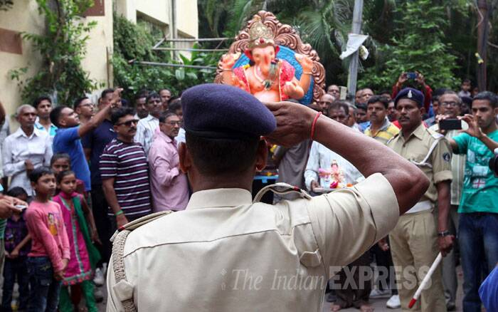 SRPF personnel welcome their Ganesh idol on Ganesh Chaturthi in Vadodara. (Source: Express Photo By Bhupendra Rana)