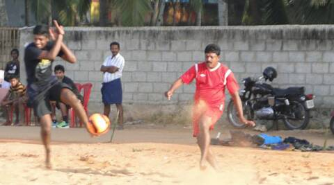 Sanju Samson (L) plays football with his father in Mulloor (Source: Facebook)