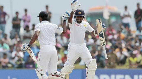 Kumar Sangakkara (left) takes a run to complete a century as teammate Mahela Jayawardene congratulates him. (Source: AP)