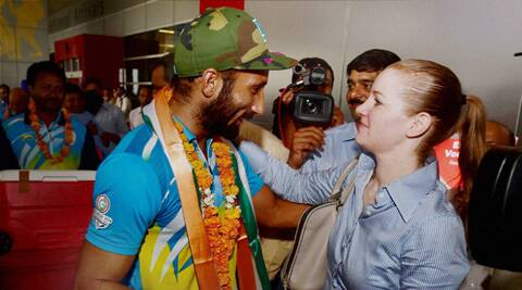 Indian hockey team captain Sardara Singh is greeted by Elena Norman, CEO Hockey India, on the team's arrival at the IGI Airport in New Delhi (Source: PTI)