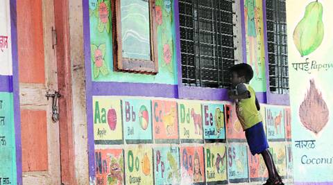 A boy peeps into his empty classroom in ZP school, Malin, on Thursday. (Source: Express photo by Arul Horizon)