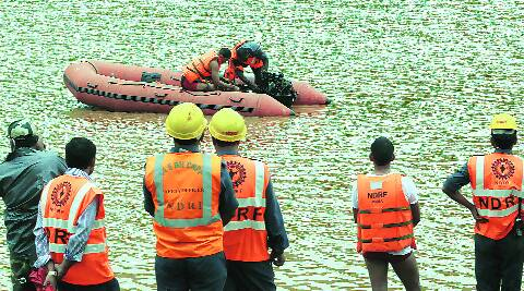 NDRF personnel search Bubra river for bodies on Wednesday. (Express photo by Sandeep Daundkar)