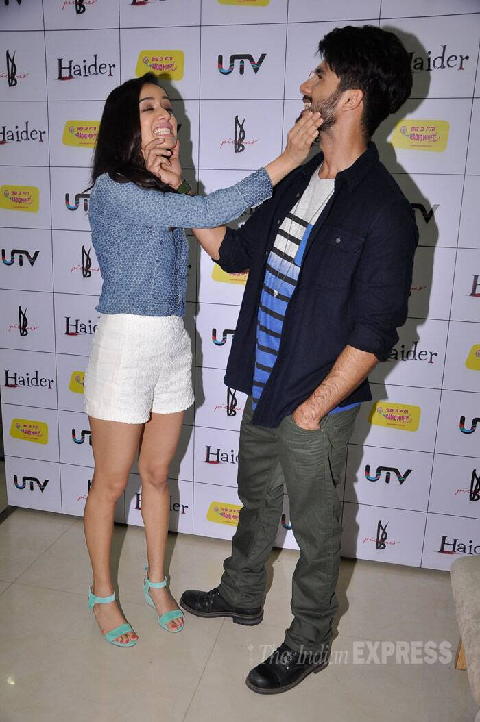 'Haider' lead pair Shahid Kapoor and Shraddha Kapoor are busy with filmy events for their upcoming film. The duo seemed unable to keep their hands off each other at the music launch of their film held at a radio station. Is this another budding romance in Bollywood? (Source: Varinder Chawla)