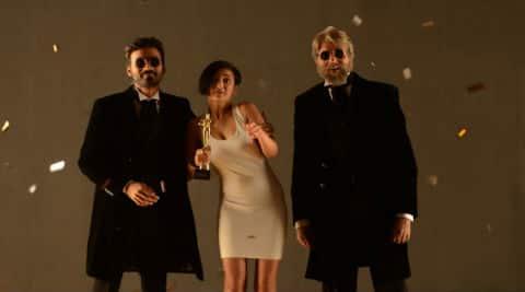 Dhanush, Akshara Haasan and Amitabh Bachchan in 'Shamitabh'.