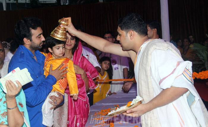 Viaan receives blessings as the priest makes him wear Lord Krishna's head gear. (Source: Varinder Chawla)