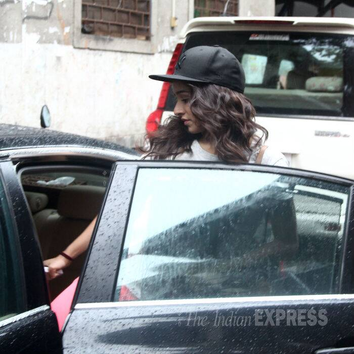 The actress wore a cap to keep her tresses dry from the rain drops. (Source: Varinder Chawla)