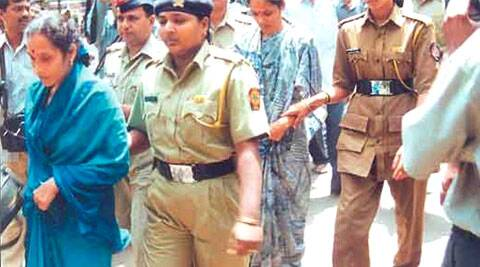 Being taken to court. Renuka (in front) is the elder sister, Seema the younger.