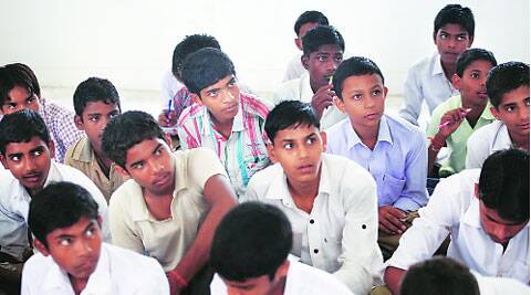 Zahid (centre, striped shirt) with his Hindu classmates ; his friend Akshay is in pale blue. ( Source: Express photo by Oinam Anand )