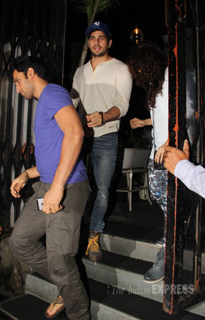Sidharth walks out with his mystery date. (Source: Varinder Chawla)