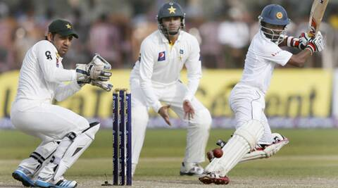 Sri Lanka's Kaushal Silva (R) plays a shot next to Pakistan's wicketkeeper Sarfraz Ahmed (L) and Azhar Ali during the second day of their first Test in Galle. (Source: Reuters)