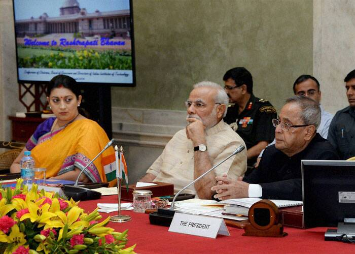 President Pranab Mukherjee, Prime Minister Narendra Modi and HRD Minister Smriti Irani during the Conference of Chairmen, Board of Governors and Directors of Indian Institute of Technology at Rashtrapati Bhavan in New Delhi. (Source: PTI)