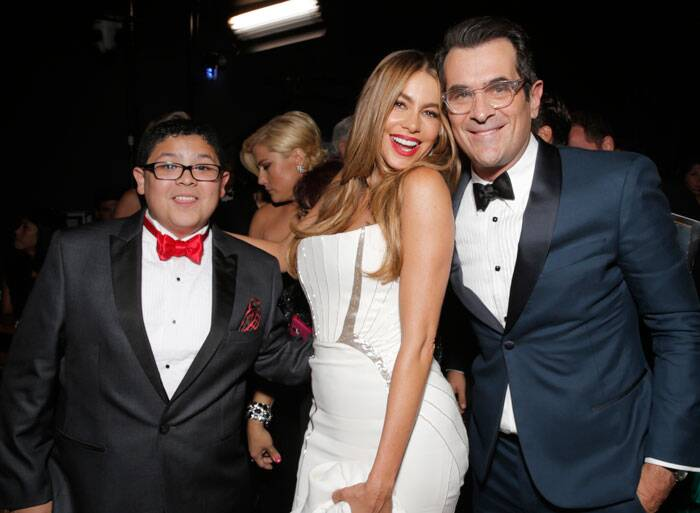 Sofia Vergara poses with her onscreen son Rico Rodriguez and Ty Burrell. (Source: AP)