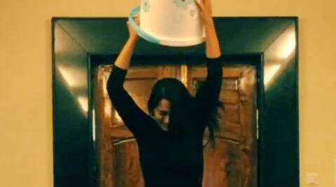 Instead of dumping icy cold water on her head, Sonakshi Sinha overturns an empty bucket.