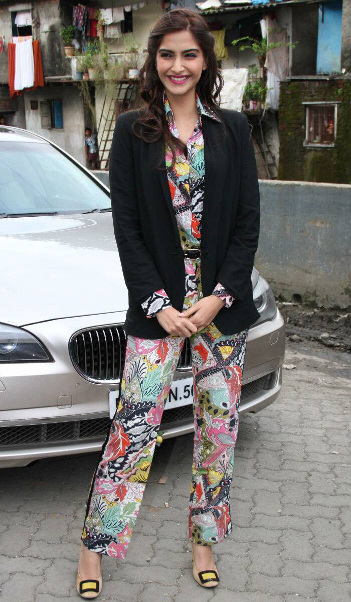 Any best dressed list is in complete without Bollywood fashionista Sonam Kapoor. Never afraid to experiment, Sonam looked fun and fabulous in printed Jonathan Saunders shirt with matching pants and a black blazer. Yellow buckled Roger Vivier flats bellies finished off her look. (Source: Varinder Chawla)
