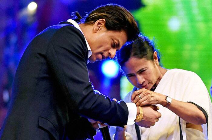 Shah Rukh Khan, who is also the brand ambassador of Kolkata, gets rakhi tied by Mamata Banerjee. (Source: PTI)