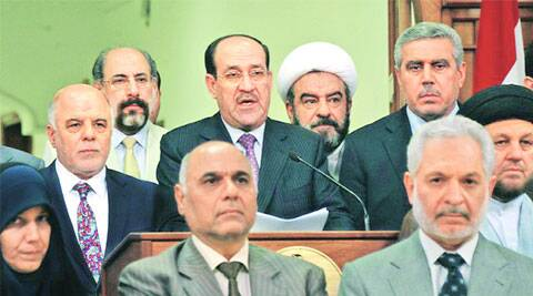 Nouri al-Maliki, with Haider al-Abadi to his left, announces he is stepping down. ( Source: Reuters )