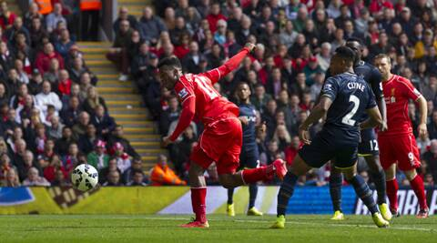 Sturridge guides the ball past the Southampton keeper to score the winning goal. (Source: AP)