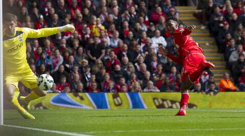 Liverpools's Raheem Sterling scores against Southampton in Anfield on Sunday. (Source: AP)
