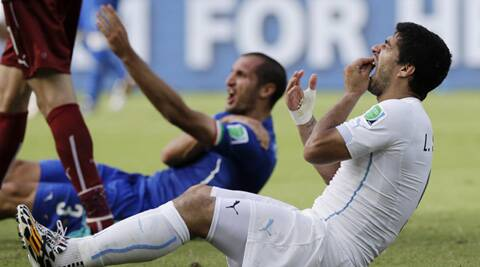 The Uruguayan star was charged with biting Italy's Georgio Chiellini during a World Cup group game in Brazil. (Source: AP)