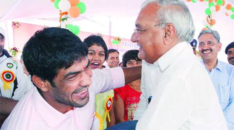 Hooda tries his hands at wrestling with Commonwealth Games gold medallist Sushil Kumar at Sonepat on Friday. Source: Express  Photo