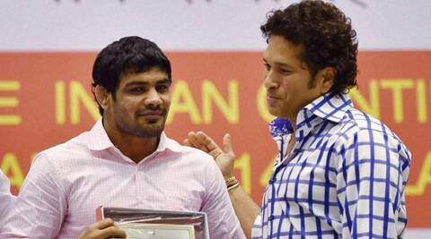 Sachin Tendulkar (R) honor gold medallist wrestler Sushil Kumar during a felicitation programme for the India's contingent for CWG 2014, in New Delhi on Friday. (Source: PTI)