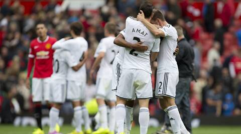 Swansea City's players celebrate after their 2-1 win over Manchester United in English Premier League opener at Old Trafford. (Source: AP)
