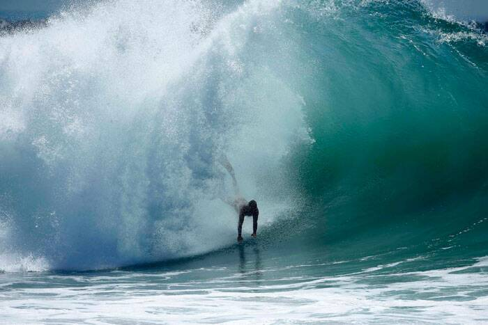 A swimmer catches a wave at 'The Wedge' wave break in Newport Beach, California August 27, 2014. Tall waves pounded the Southern California coast on Wednesday from Hurricane Marie in the Pacific Ocean, causing coastal flooding in Seal Beach, California, and forcing lifeguards to conduct rescues. (Source: Reuters)