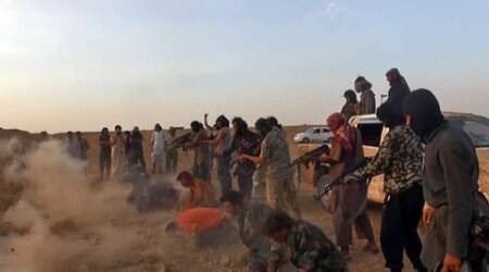 Masked gunmen of the IS group shooting seven men kneeling on the ground in front of them in the aftermath of the group's takeover of the Tabqa air base. (Source: AP)