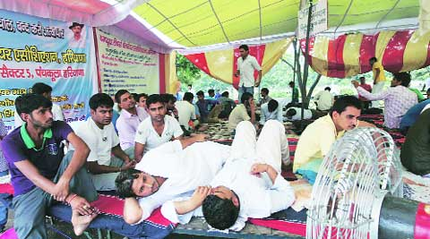 Computer teachers sit on dharna in Sector 5, Panchkula, on Saturday.
