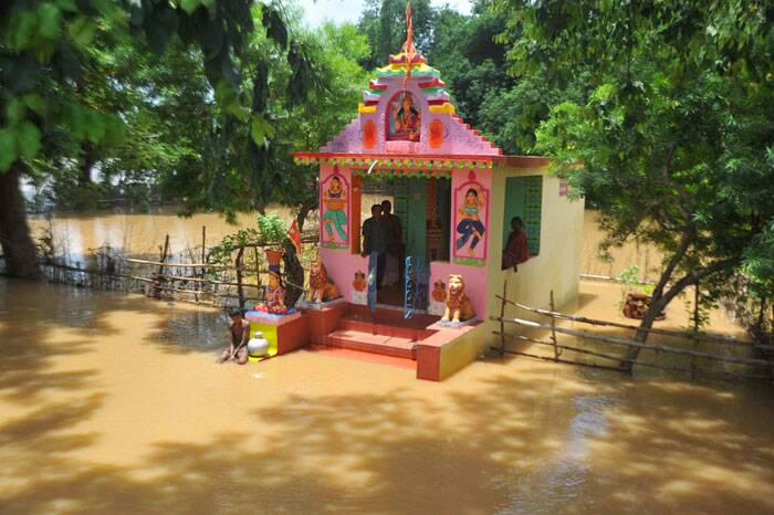 A temple gets submerged in flood waters of river Daya in Kapudia village near Jatni in Khurda district on Wednesday. (Source: PTI)