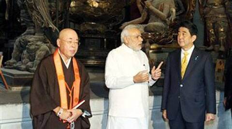 Indian Prime Minister Narendra Modi, center, and his Japanese counterpart Shinzo Abe, right, tour at Toji Temple in Kyoto, western Japan Sunday, Aug. 31, 2014. ( Source: AP )