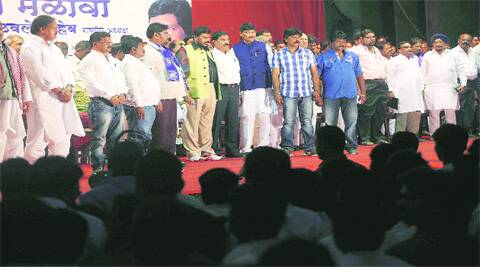 RPI leader Ramdas Athawale, along with other leaders, at a party rally organised to pay tributes to Malin victims, at Ganesh Kala Krida Manch Sunday. ( Source: Express photo by Pavan Khengre )