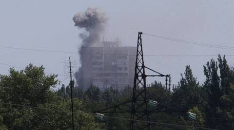 Smoke from shelling rises over a residential apartment house in Shakhtarsk, Donetsk region, eastern Ukraine on Monday, July 28, 2014. (Source: AP)