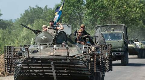 Ukrainian government troops roll on their military vehicles in Donetsk region. (Source: AP)